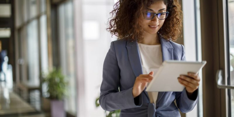 Young businesswoman using digital tablet indoors